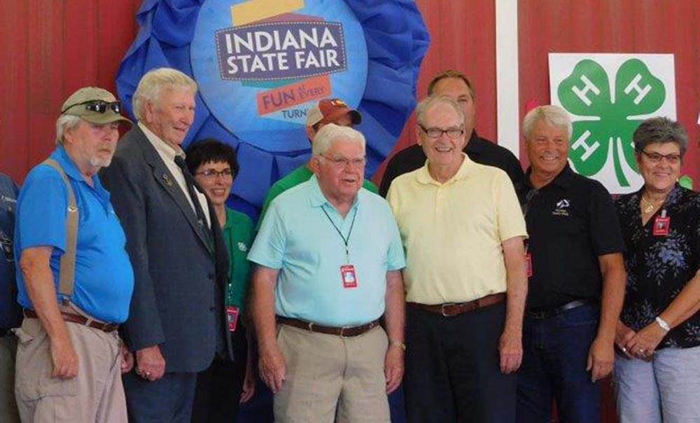 Jay County's Jim Bob McEwen, second from left, stands with others who were honored last week with state passes to the Indiana State Fair. McEwen has been a fixture at the state fair for decades with his pair of oxen and border collie demonstrations. (Special to The Commercial Review/Ami Huffman)