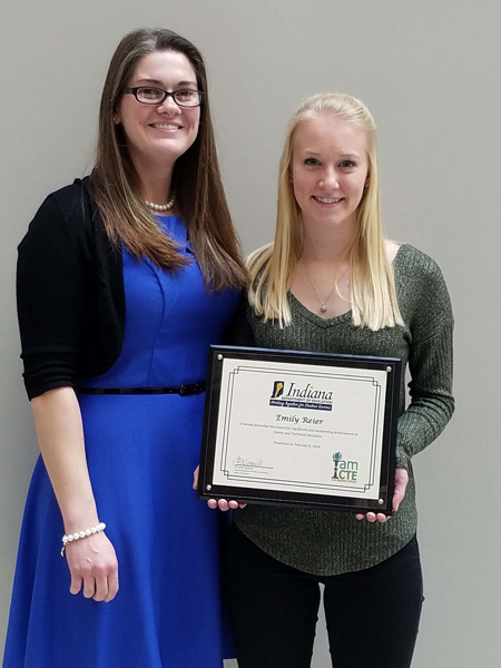 Emily Reier, right, a Jay County High School senior, was honored this month as a winner of one of the Indiana Department of Education Awards for Excellence. She is pictured with JCHS vocational agriculture teacher Brittany Kloer, who nominated her for the honor. (Photo provided)